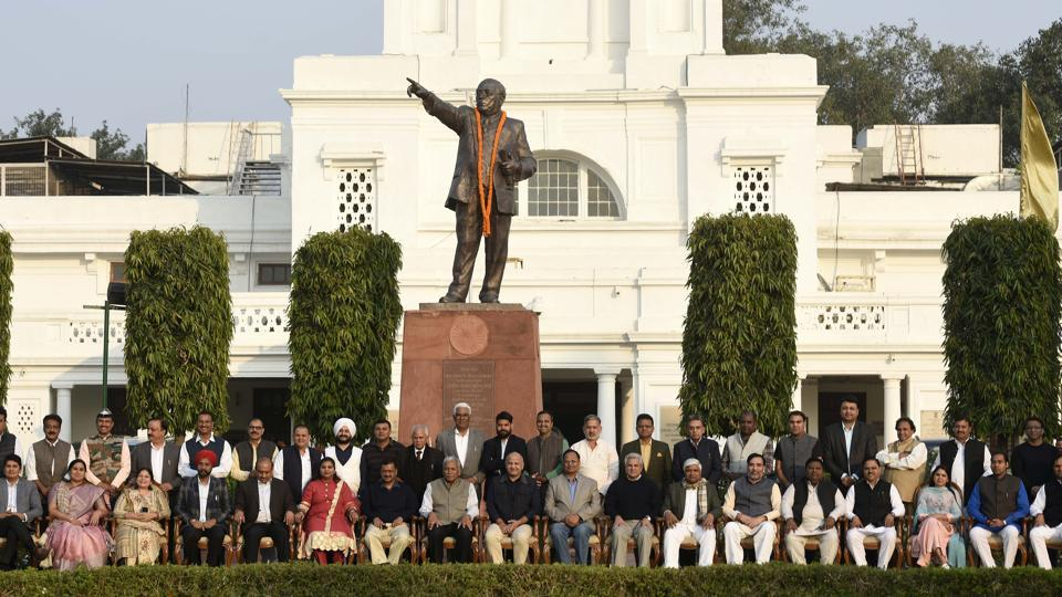 Delhi Chief Minister Arvind Kejriwal and other MLAs pose for a picture during the Delhi Assembly session, at Vidhan Sabha, in New Delhi, on Monday, December 2, 2019.  The winter session of the House ended on Dec 3, 2019.