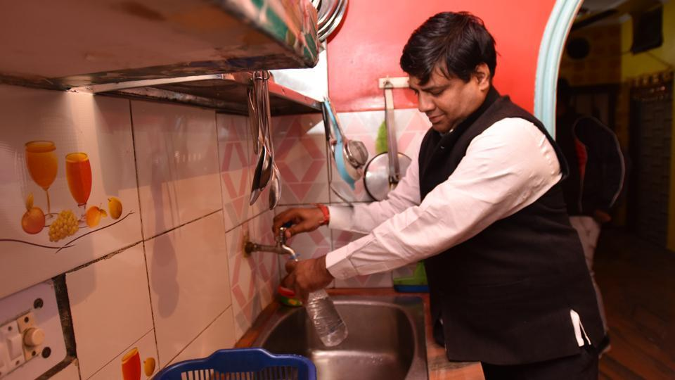 Delhi Jal Board (DJB) vice-chairman Dinesh Mohaniya collects water samples from a resident's house, at Lado Sarai, in New Delhi on Monday, November 25, 2019.