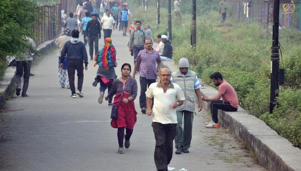 People walk in the winter morning at Wadgaon on Sinhgad road in Pune.