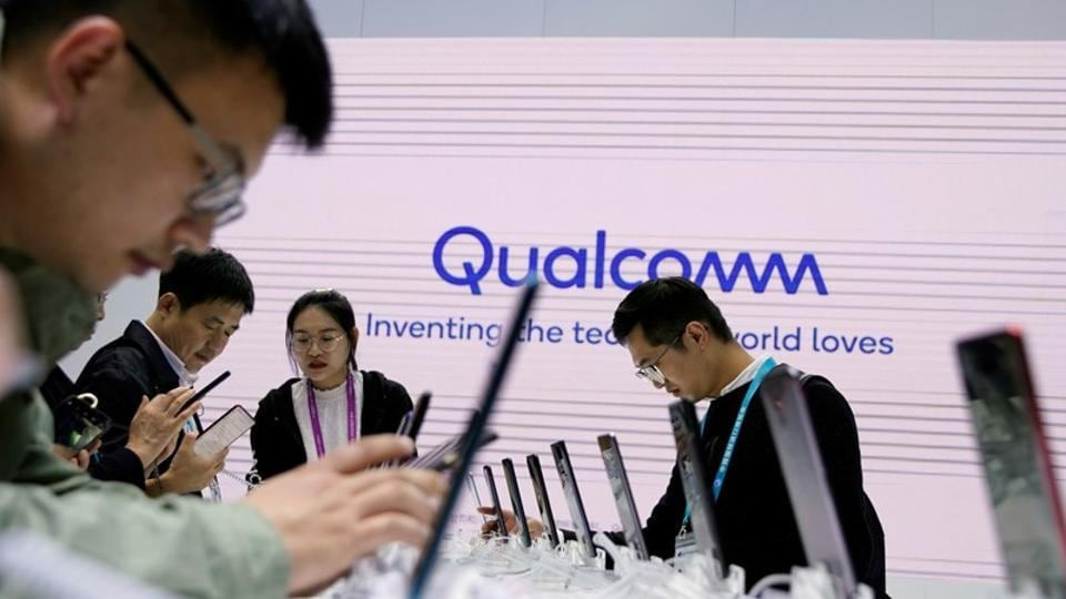 A Qualcomm sign is seen at the second China International Import Expo (CIIE) in Shanghai, China November 6, 2019. REUTERS/Aly Song/Files