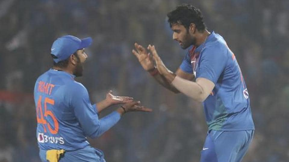 Indian players Shivam Dube, right, with Rohit Sharma celebrate the wicket of Bangladesh's Mushfiqur Rahim during their third Twenty20 international cricket match against India in Nagpur.