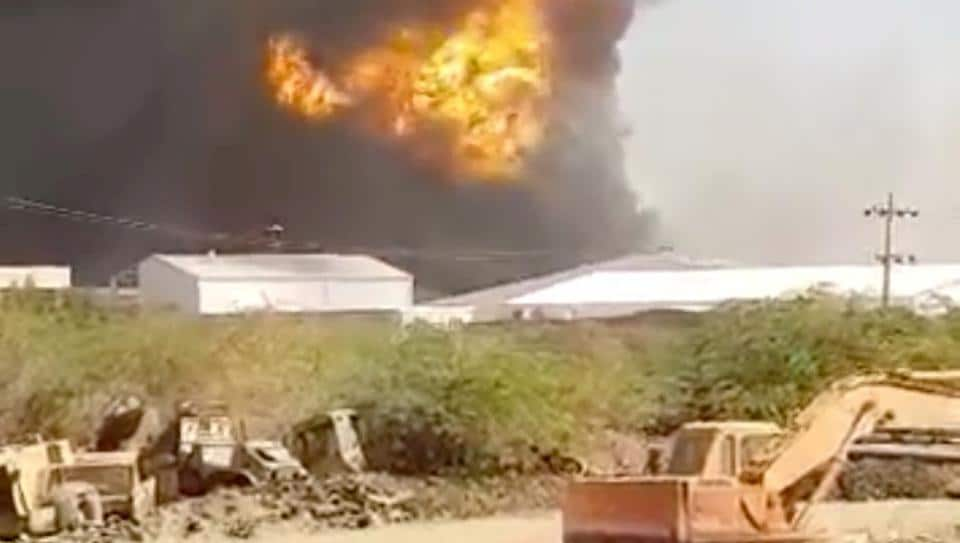Smoke rises following a ceramics factory explosion in Khartoum, Sudan on December 3.