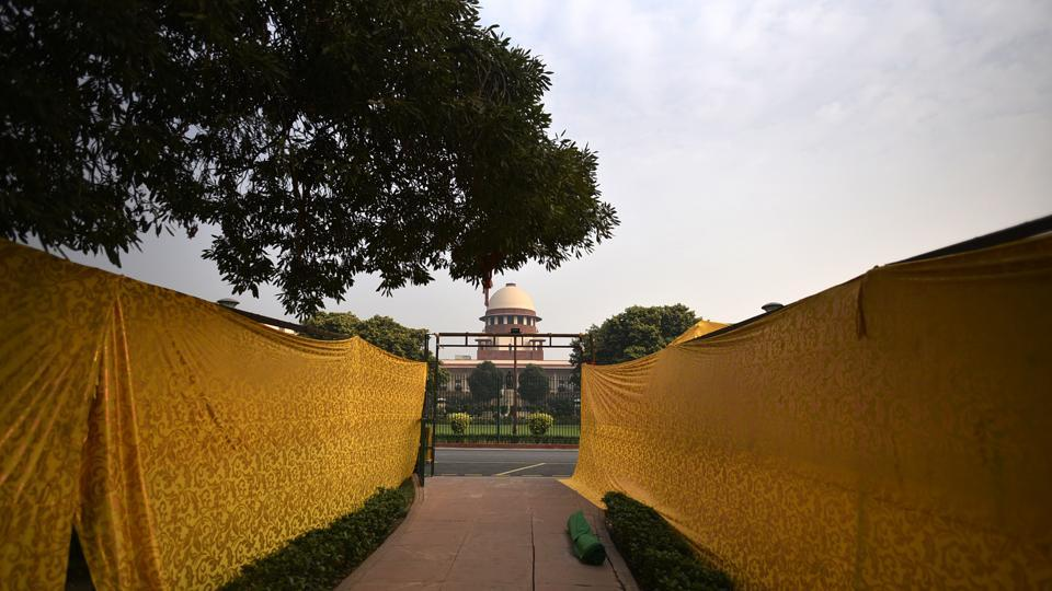 A view of the Supreme Court seen through a tent on Constitution Day in New Delhi.