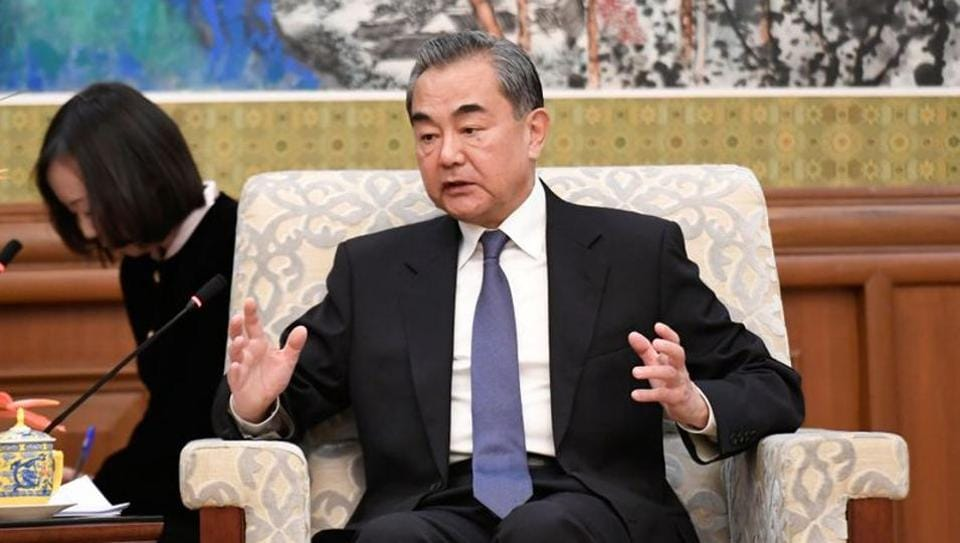 China's top diplomat Wang Yi speaking during a meeting with former Ethiopian President Mulatu Teshome in Beijing in October, 2019.