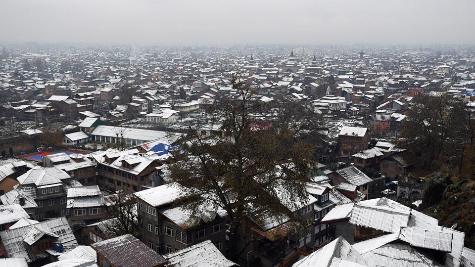 A view of snow covered roofs of the residential houses after fresh snowfall in Srinagar on Thursday.