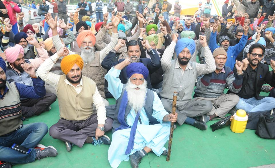 PSEB Employees' Joint Forum members protesting against the Punjab government in front of the PSPCL head office in Patiala on Wednesday.