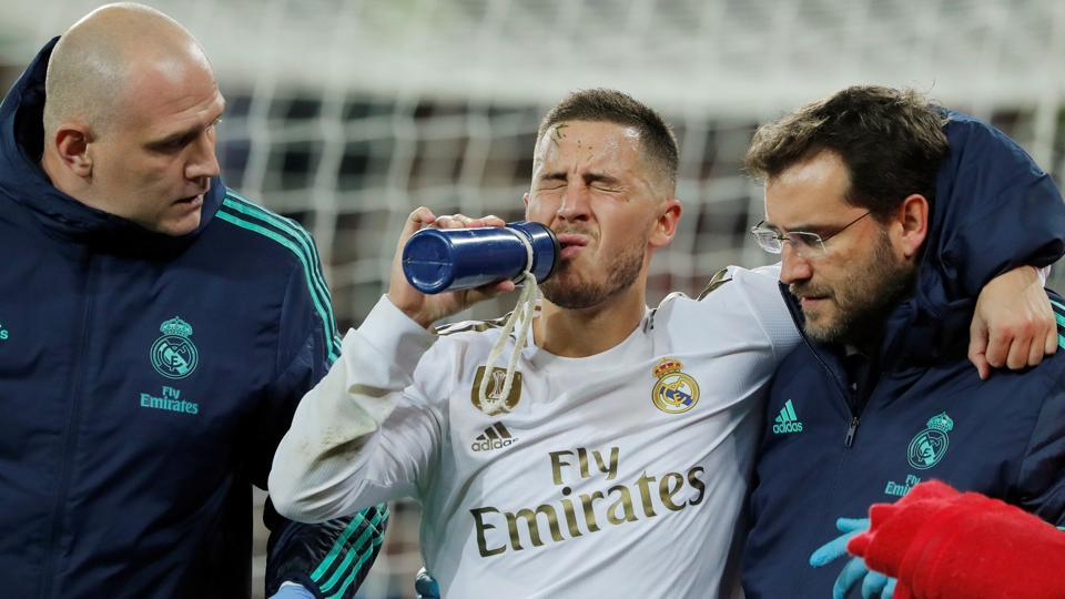 Real Madrid's Eden Hazard receives medical attention after sustaining an injury.