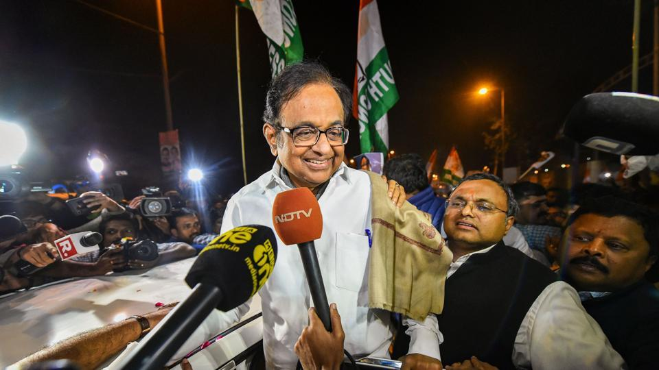 Senior Congress leader P Chidambaram, with his son Karti Chidambaram, talks to the media after being released from Tihar jail in New Delhi.