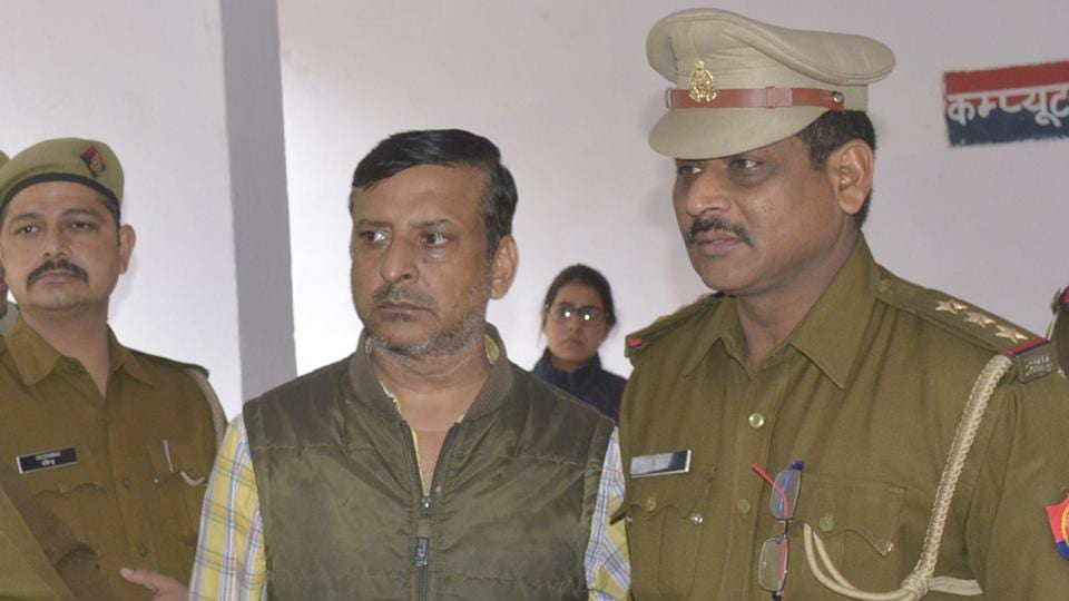 Businessman Gulshan Vasudeva's brother in law Rakesh Verma (in centre)  seen in Ghaziabad Police custody on charges of allegedly abetting the former's suicide.