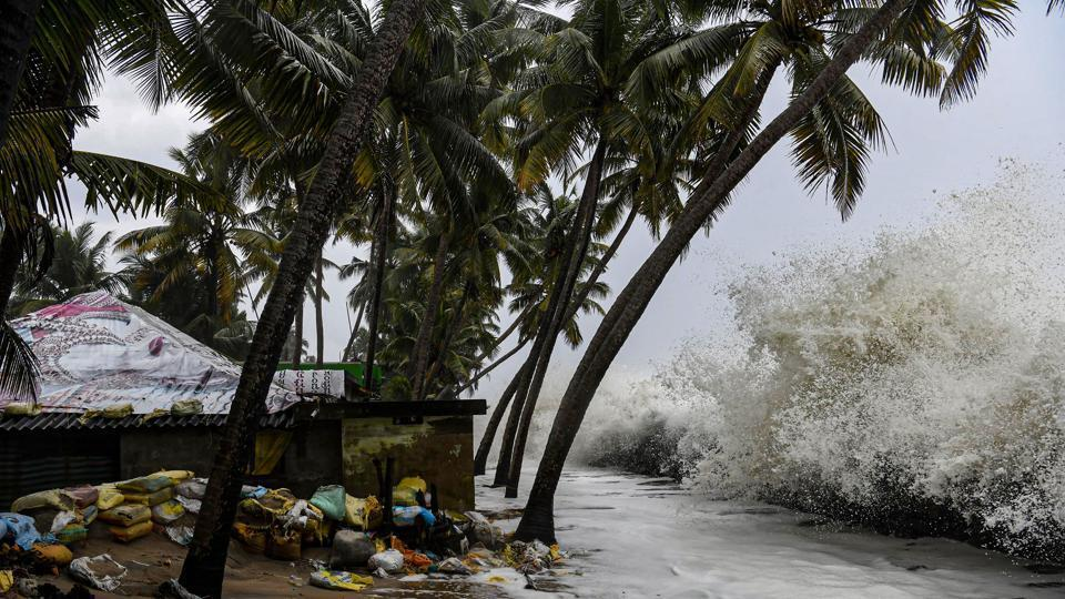 Sea waves crash close to a habitation in Chellanam area of Kochi, Thursday, Oct. 31, 2019.