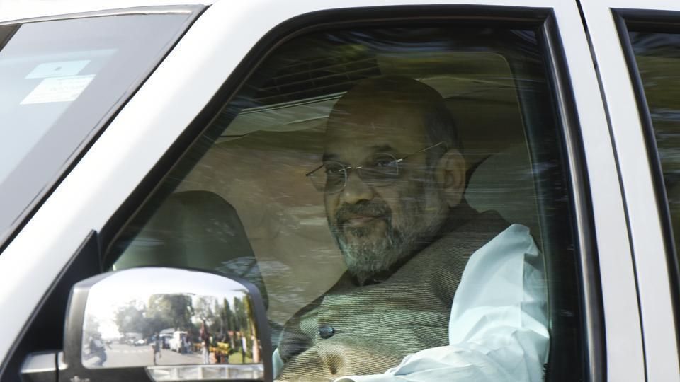 Union Home Minister Amit Shah arrives to attend the ongoing winter session, at Parliament House, in New Delhi on Friday, November 29.