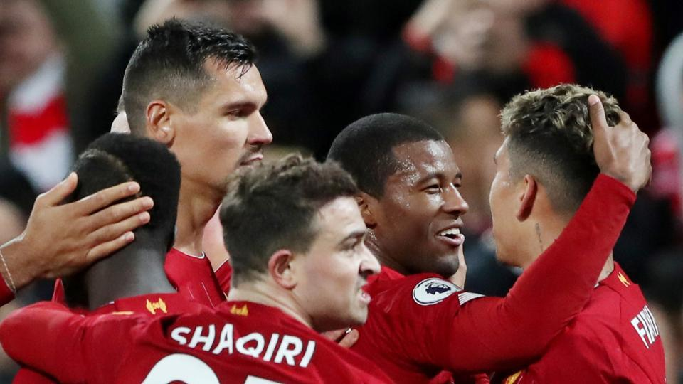 Liverpool's Georginio Wijnaldum celebrates scoring their fifth goal with teammates
