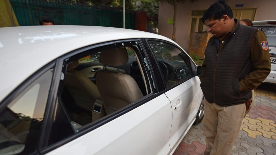 A policeman investigates the vehicle in which a doctor allegedly shot a woman dead and then used the same revolver to kill himself, at Rohini, in New Delhi, on Wednesday, December 4, 2019.