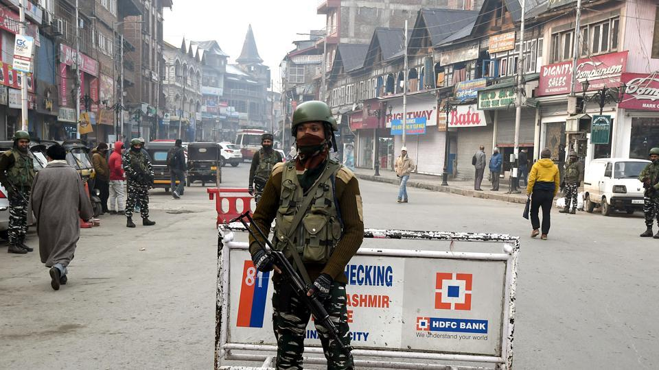 Security personnel stand guard at Lal Chowk in Srinagar on Thursday.