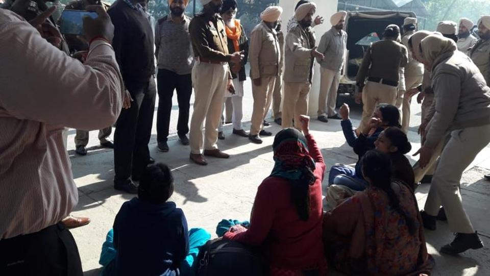 Women protesters holding a dharna in front of the deputy commissioner's office in Faridkot on Friday. Police detained them for an hour before releasing them as their protest was causing inconvenience to people.