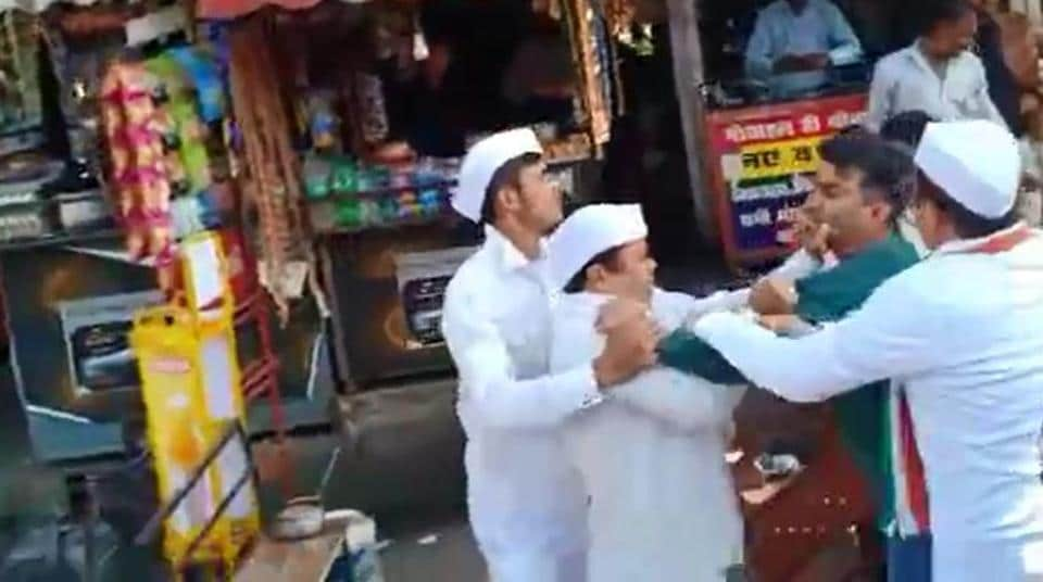 Bisht seen in a scuffle with Nainital Congress leaders during a protest against high prices of onions.