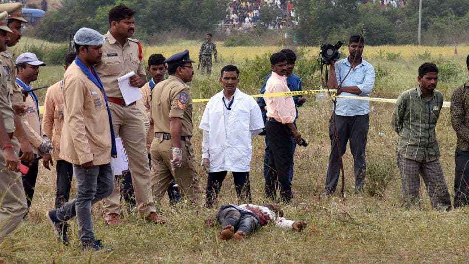 Dead bodies of the accused in the rape and murder of the woman veterinarian seen at the spot where they were killed in an encounter with the police, in Hyderabad on Friday.