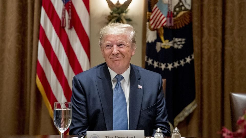 President Donald Trump smiles during a luncheon with members of the United Nations Security Council in the Cabinet Room at the White House in Washington, Thursday.