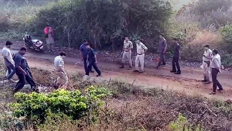 Police at the site of an alleged encounter, where four accused in the rape and murder of a veterinary doctor were shot dead, on the outskirts of Hyderabad on Friday.