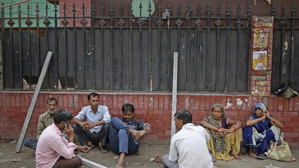 Indian daily wage laborers and construction workers wait to get hired on the outskirts of New Delhi, India. India's economy, once one of the fastest growing in the world, is braking in a blow to the labor-intensive manufacturing sector. Growth slipped to 5% in the April-June quarter, the slowest pace in six years, and many economists believe that Prime Minister Narendra Modi's signature economic policies are at least partly to blame.