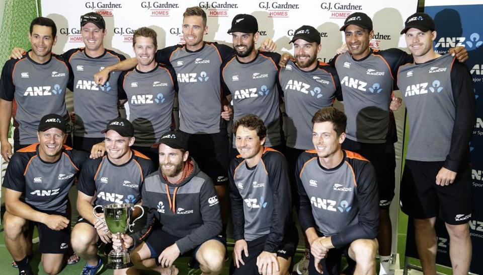 New Zealand players pose with the trophy after the second cricket test between England and New Zealand at Seddon Park.