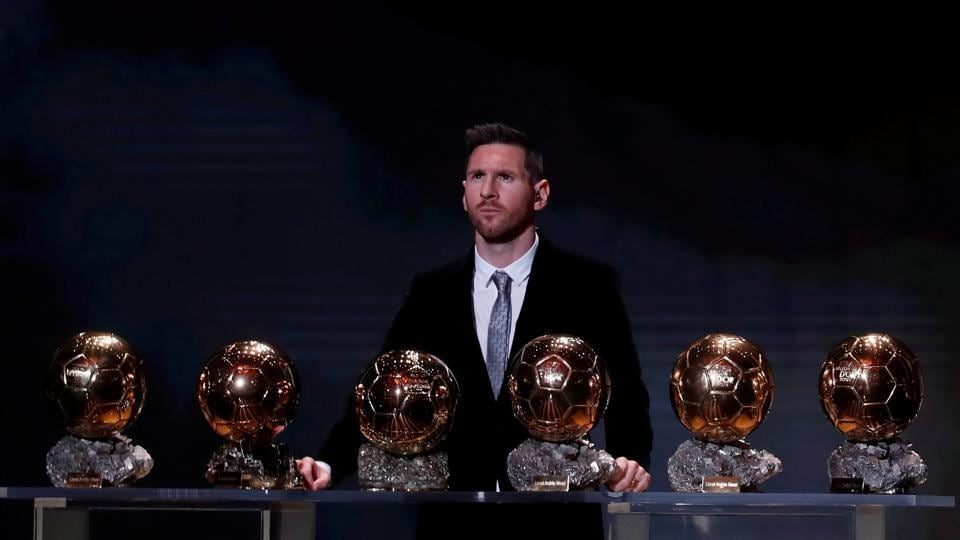 Barcelona's Lionel Messi with his record six Ballon d'Or trophies during this year's award ceremonies at the Theatre du Chatelet in Paris, France. (Christian Hartmann / REUTERS)