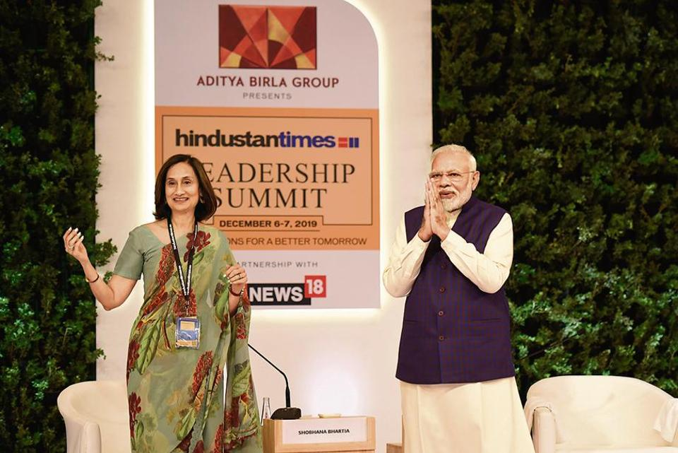 Narendra Modi, Prime Minister of India and Shobhana Bhartia, Chairperson and Editorial Director, HT Media Limited during the Hindustan Times Leadership Summit, at Taj Palace, in New Delhi.