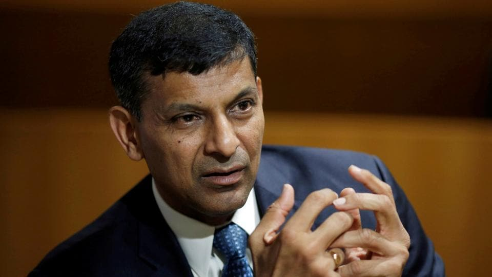 India's former Reserve Bank of India (RBI) Governor Raghuram Rajan, gestures during an interview.