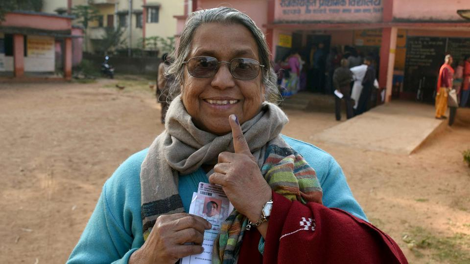 Elderly woman showing mark of indelible ink after casting her vote at a polling booth during the second phase of Jharkhand Assembly elections at Karge village in Ranchi.