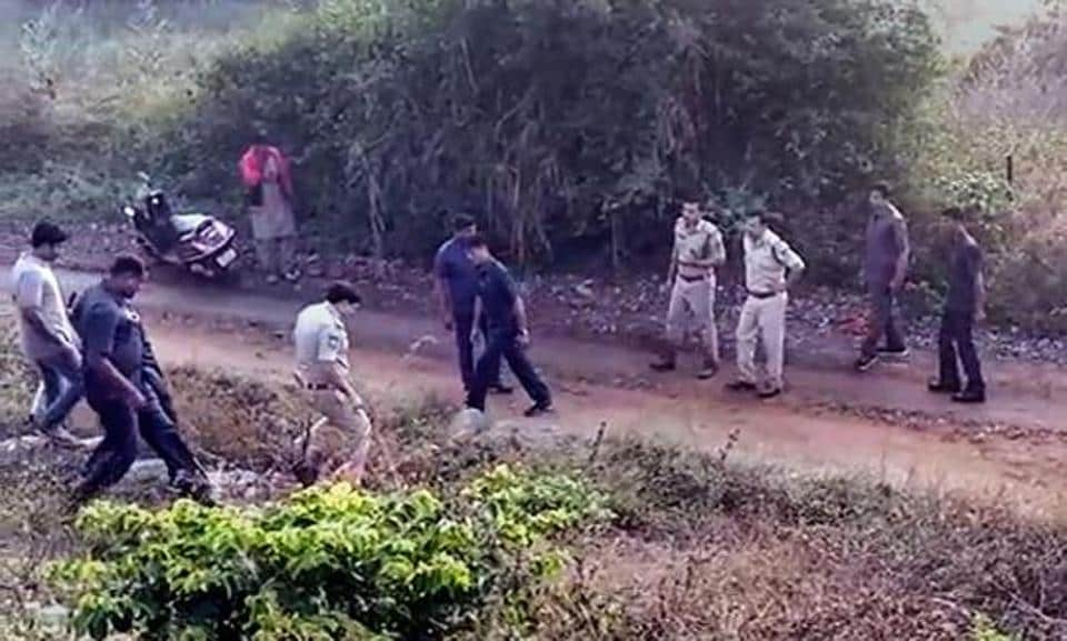 Police at the site of the alleged encounter of the four accused in the rape and murder of a veterinary on the outskirts of Hyderabad on Friday morning.
