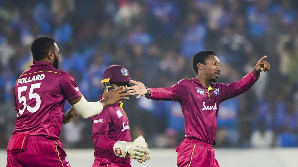 West Indies bowler Khary Pierre with teammates celebrates the dismissal.