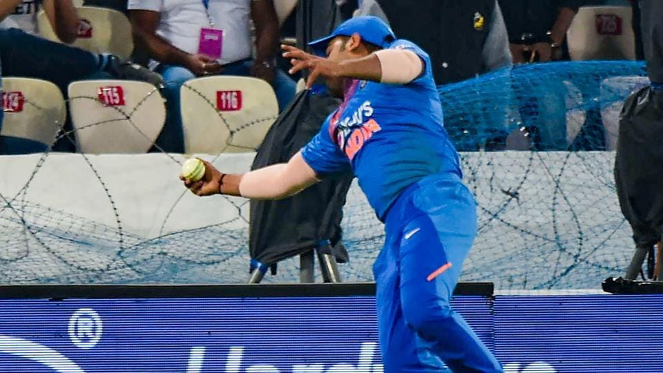 India's Rohit Sharma jumps to take a catch.