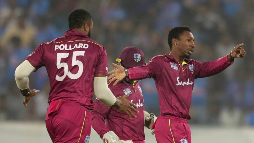West Indies' Kieron Pollard celebrates with teammates.