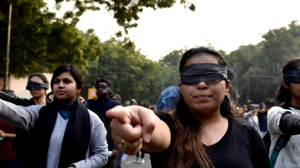 Protestors blindfold themselves during a protest in solidarity with rape victims and to oppose violence against women in India, in New Delhi on Saturday.