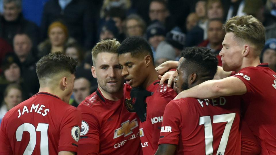 Manchester United's Marcus Rashford, center, celebrates with teammates after scoring his side's opening goal.