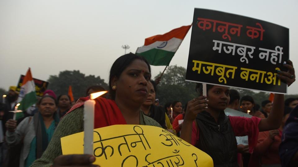 New Delhi, India- December 7, 2019: Supporters of Delhi Commission for Women (DCW) chairperson Swati Maliwal hold placards to demand justice for the rape and murder of the Unnao rape survivor who was burnt alive by her alleged rapists, at Shahidi Park, ITO, in New Delhi, India, on Saturday, December 07, 2019. Maliwal is on a hunger strike for the fifth consecutive day to demand capital punishment for rape suspects within six months of their conviction. (Photo by Sonu Mehta/ Hindustan Times)