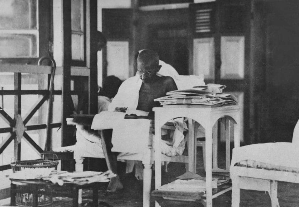 Mahatma Gandhi reading his correspondence after being released from prison, May 20, 1924