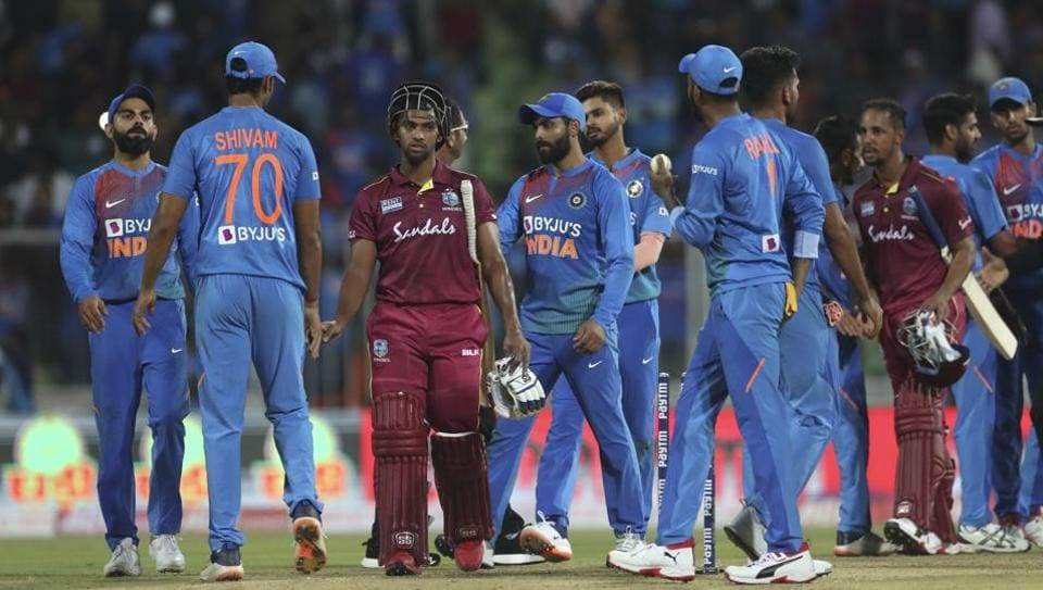 West Indies' Nicholas Pooran, third left, and Lendl Simmons, third right, shake hands with Indian players after their win in the second Twenty20 international.