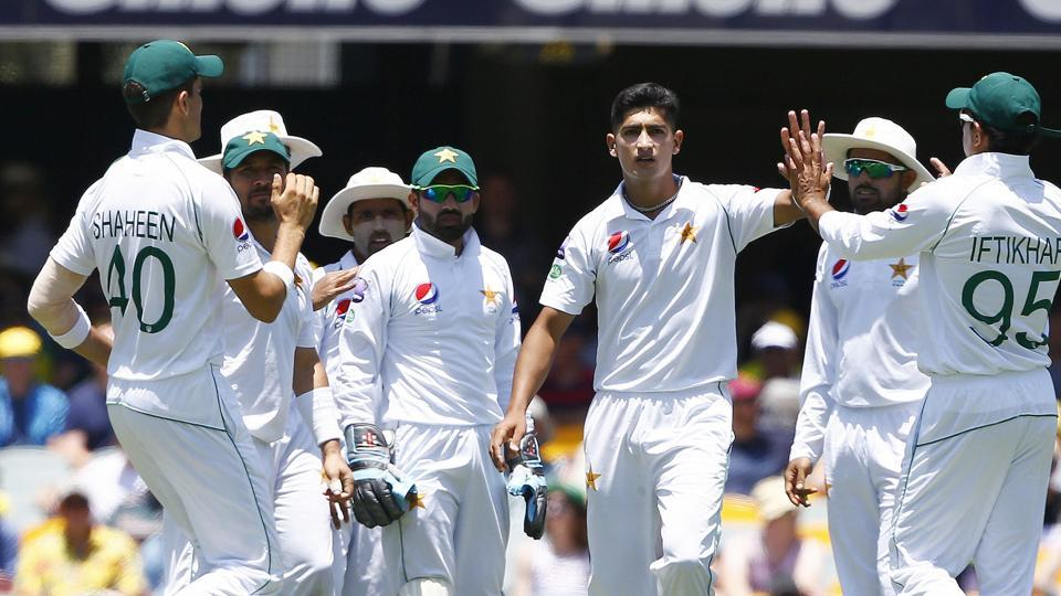 File image: Pakistan's Naseem Shah, center, celebrates with his team after getting the wicket of Australia's David Warner during their cricket test match in Brisbane.