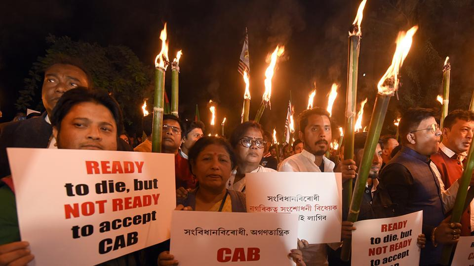 People take part in torchlight protest rally against the Citizenship (Amendment) Bill  in Guwahati on Saturday.