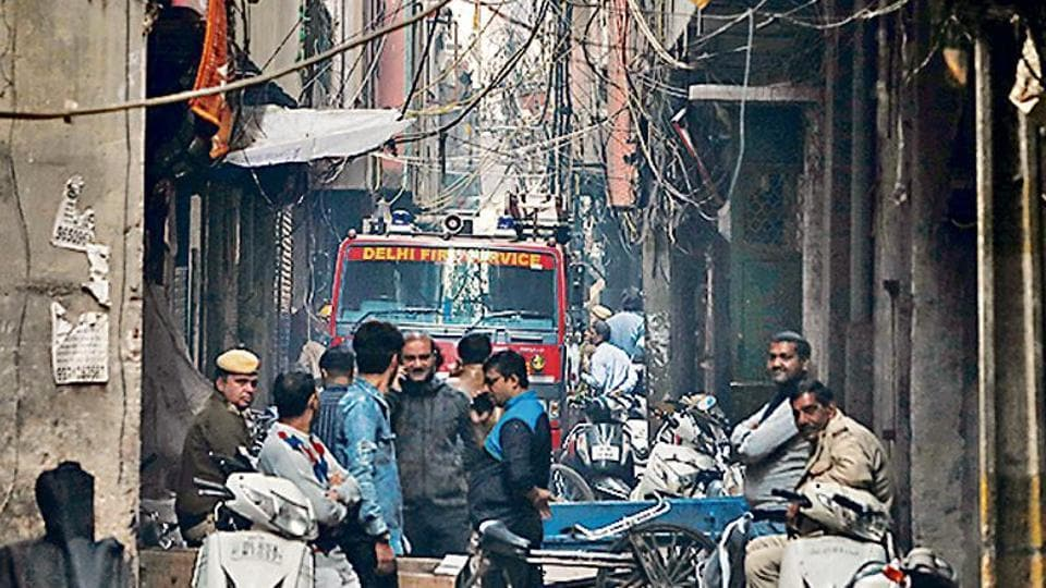 A fire engine is seen at the site of a fire that swept through a factory where laborers were sleeping, in New Delhi