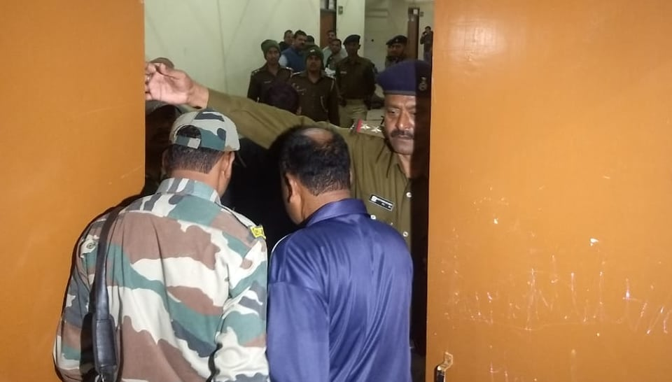 Police officials and others at the spot where a constable of the Chhattisgarh Armed Force shot dead his company commander before committing suicide in Khelgaon, Ranchi on Monday.