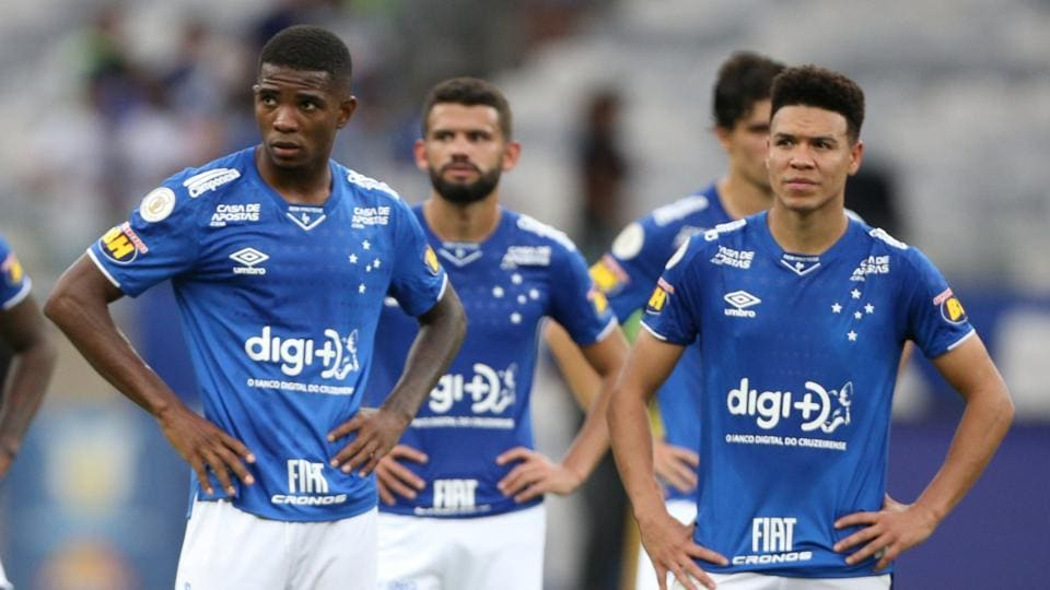 Cruzeiro players watch the clashes between the riot police and fans