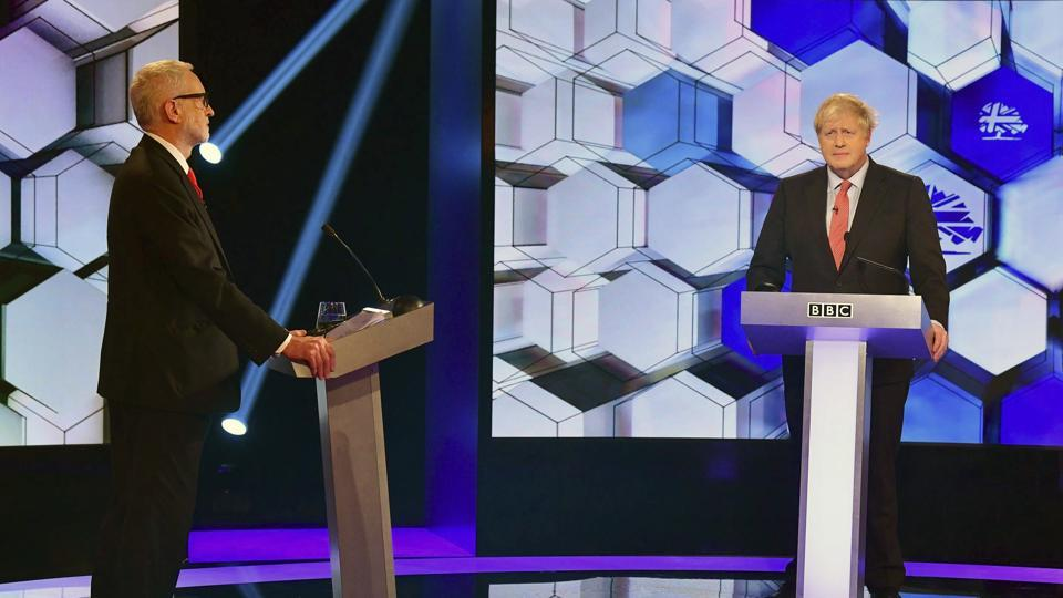 Opposition Labour Party leader Jeremy Corbyn, left, and Britain's Prime Minister Boris Johnson, during a head to head live Election Debate at the BBC TV studios in Maidstone, England. Britain's Brexit is one of the main issues for political parties and for voters, as the UK prepares for a General Election on Dec. 12.