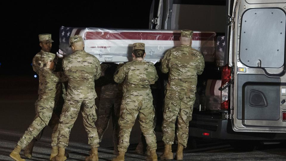 An Air Force carry team loads the transfer case containing the remains of Navy Seaman Apprentice Cameron Scott Walters, of Richmond Hill, Ga., into the transfer vehicle Sunday, Dec. 8, 2019, at Dover Air Force Base, Del. A Saudi gunman killed three people including Walters in a shooting at Naval Air Station Pensacola in Florida. (AP Photo/Cliff Owen)