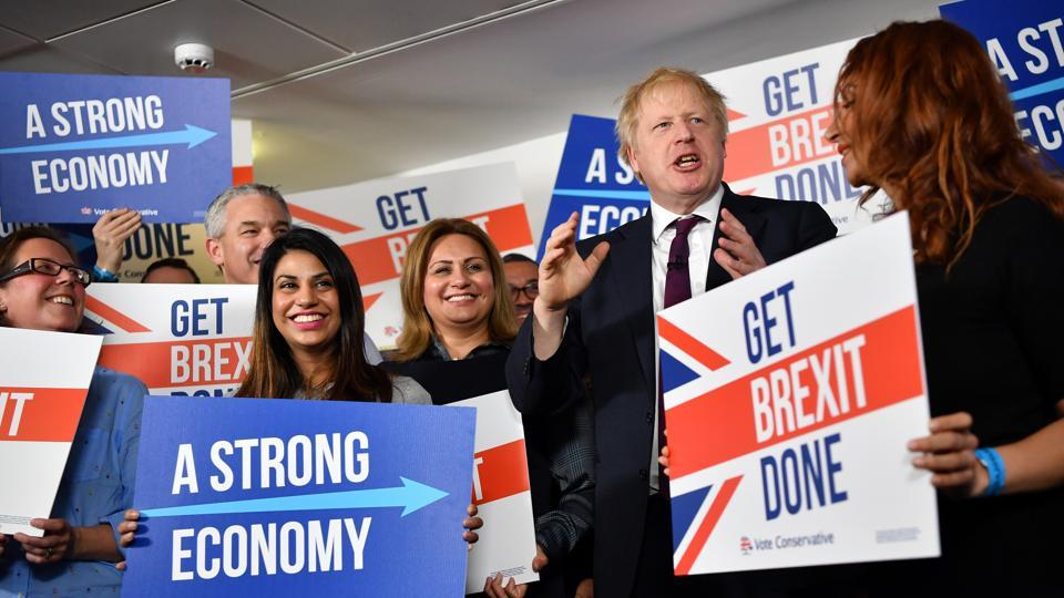 Britain's Prime Minister Boris Johnson speaks to activists and supporters as he poses for a photograph at the Conservative Campaign Headquarters Call Centre in central London