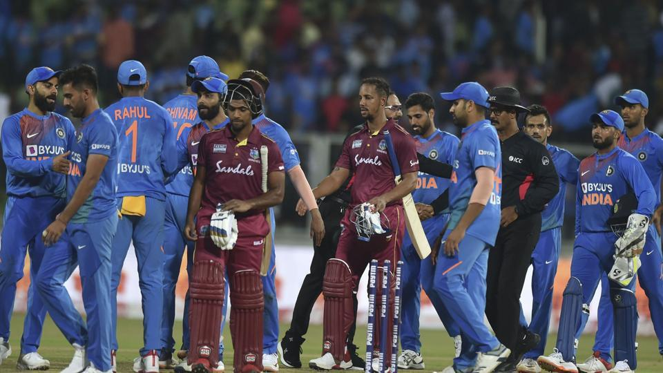 West Indies players Lendl Simmons and Nicholas Pooran being greeted by Indian team.