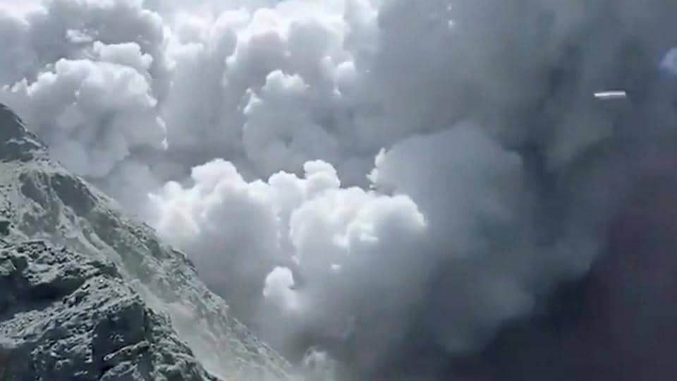 Thick smoke from the volcanic eruption of Whakaari, also known as White Island, is seen in New Zealand, December 9, 2019, in this image obtained via social media.