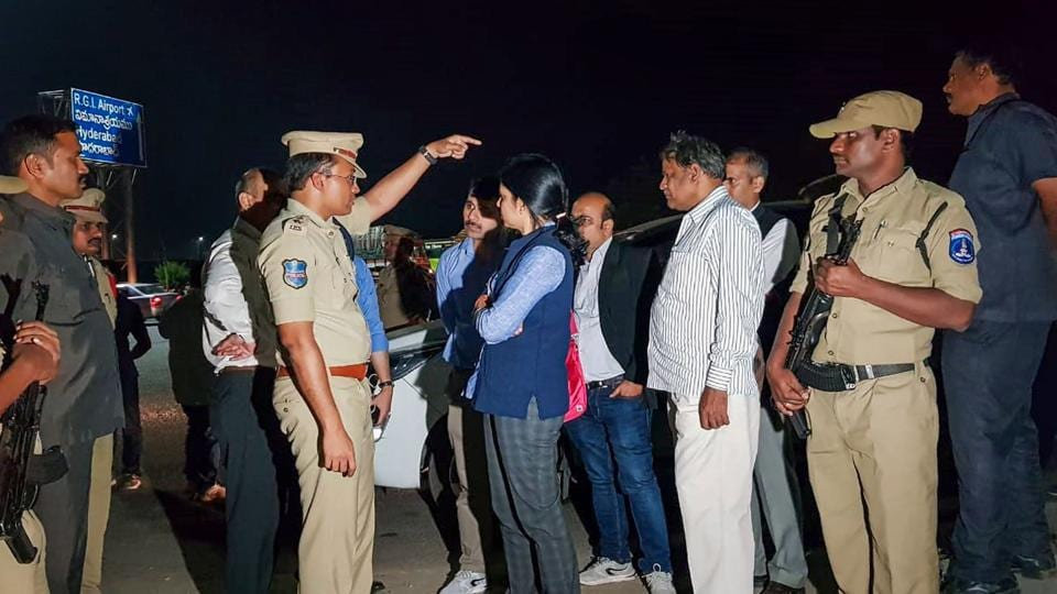 National Human Rights Commission (NHRC) members visit the encounter site where yesterday police shot dead four accused involved in the rape-and-murder case of a woman veterinarian, at Shamshabad in Hyderabad.
