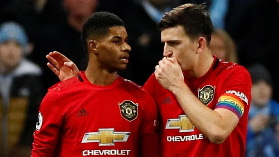 Manchester United's Harry Maguire (R) with Marcus Rashford.